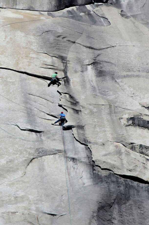 Tommy Caldwell (bottom) and Kevin Jorgeson reach pitch 29 on the face of El Capitan during their record-setting free climb in in Yosemite National Park. Photo: Michael Macor / The Chronicle / ONLINE_YES