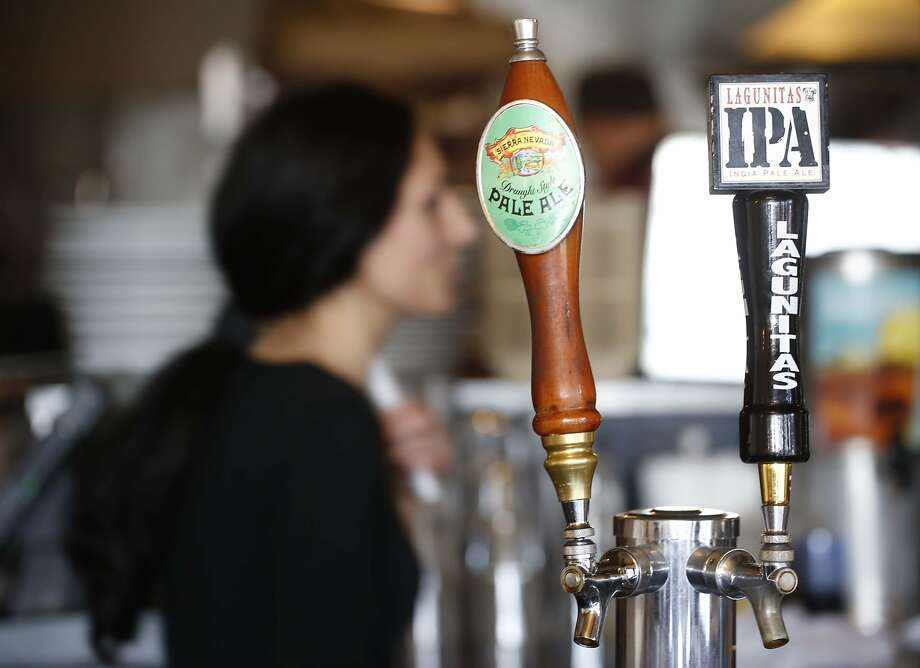 Sierra Nevada and Lagunitas IPA draft beer taps sit next to each other at Flipper's Gourmet Burgers on Hayes Street in San Francisco, Calif. on Wednesday January 14, 2015 Photo: Mike Kepka, SFC