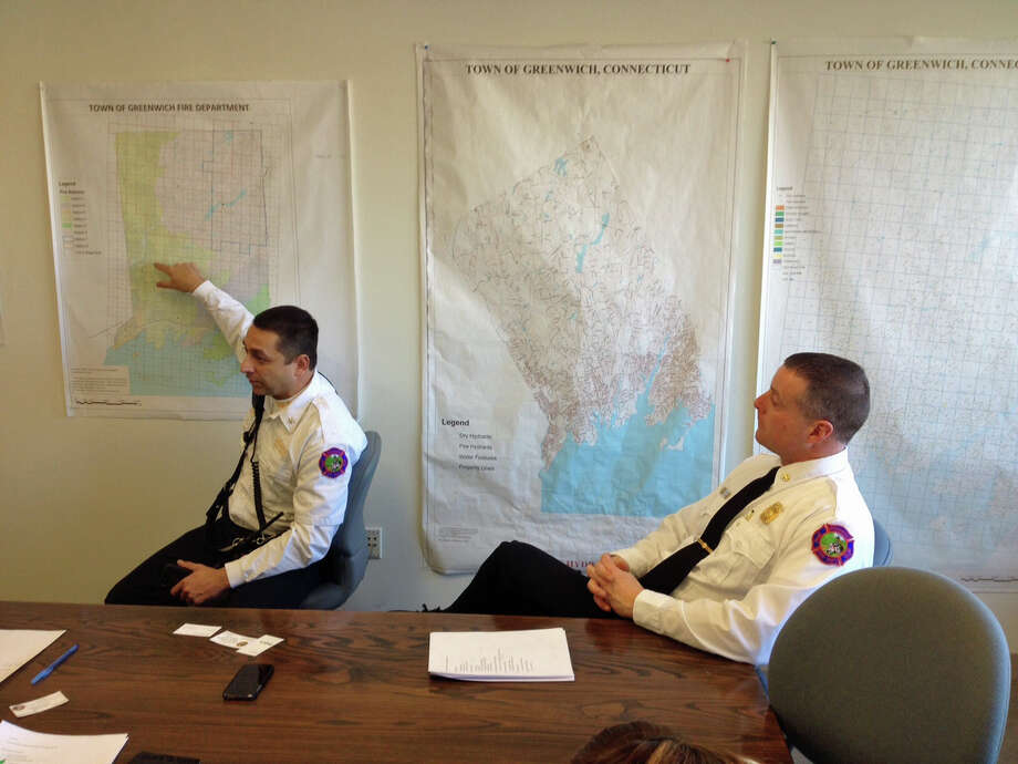 Deputy Chief Thomas Zack, left, and Assistant Chief Robert Kick discuss Fire Department response times at a press briefing outlining upcoming initiatives. Photo: Robert Marchant, Anne W. Semmes / Greenwich Time