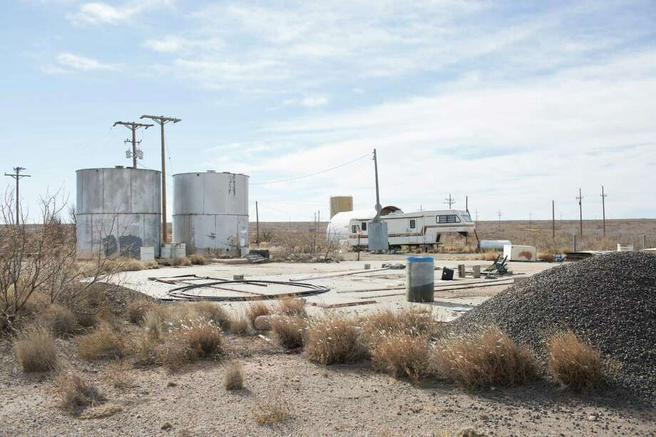 A concrete pad that sits above a decommissioned missile silo built beneath the desert floor, that is for sale outside Roswell, N.M., Dec. 21, 2014. The 25-acre parcel, a 20-mile drive from Roswell's downtown, has a worn trailer where the former owner lived. Photo: RICK SCIBELLI JR., New York Times / NYTNS