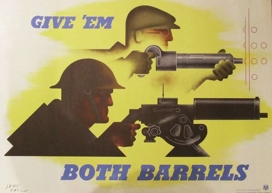 """Jean Carlu's ìGive ëem Both Barrells"""" (1941) rallied Americans to both support the fighting and boost factory production on the homefront. The poster is part of an exhibit of World War II at the Fairfield Museum and History Cen6ter. Fairfield CT. January 2015. Photo: Fairfield Citizen/Contributed / Fairfield Citizen"""