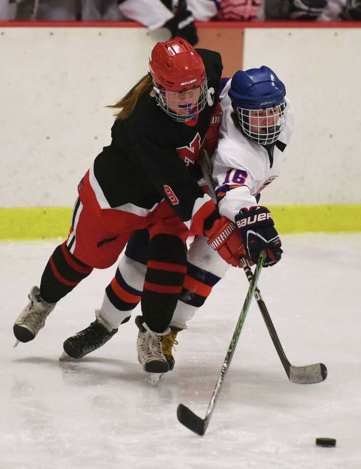 New Canaan's Mackenzie Lewis (9) and Stamford-Westhill-Staples' Kyra DalBello (16) battle for the puck in Stamford-Westhill-Staples' 7-3 win over New Canaan in the high school girls hockey game at Terry Conners Rink in Stamford, Conn. Wednesday, Jan. 14, 2015. Photo: Tyler Sizemore / Greenwich Time