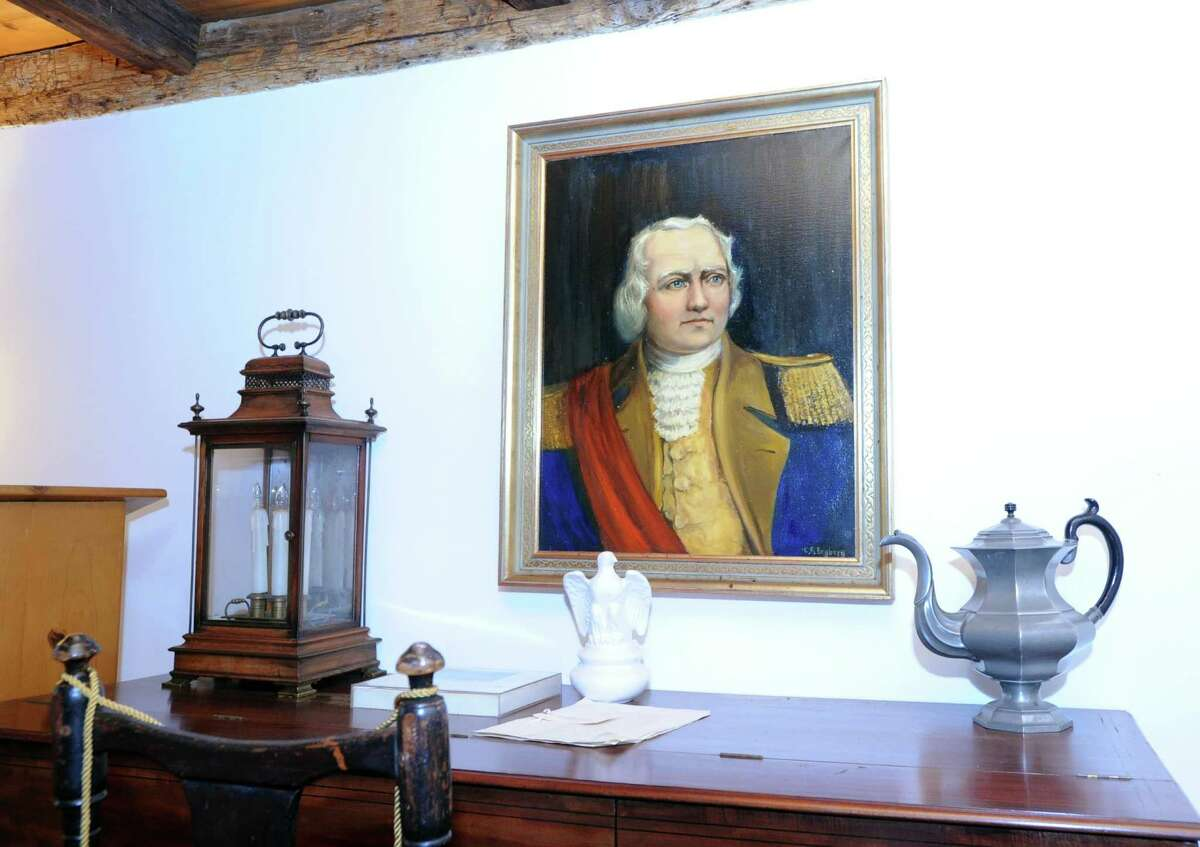 Israel Putnam (1718-1790) became a war hero during his service in both the Revolutionary War and the French and Indian War. But before that, Putnam was celebrated in the town ofPomfret for crawling into a wolf's den and killing the last known wolf in Connecticut. Having escape from invading British forces in 1779, General Putnam was remembered this year in a re-enactment at Putnam Hill Park in Greenwich, where both the park and Putnam Cottage were re-dedicated. Seen here: a portrait of Gen. Israel Putnam hangs on the wall of the historic Putnam Cottage at 243 E. Putnam Ave. in Greenwich