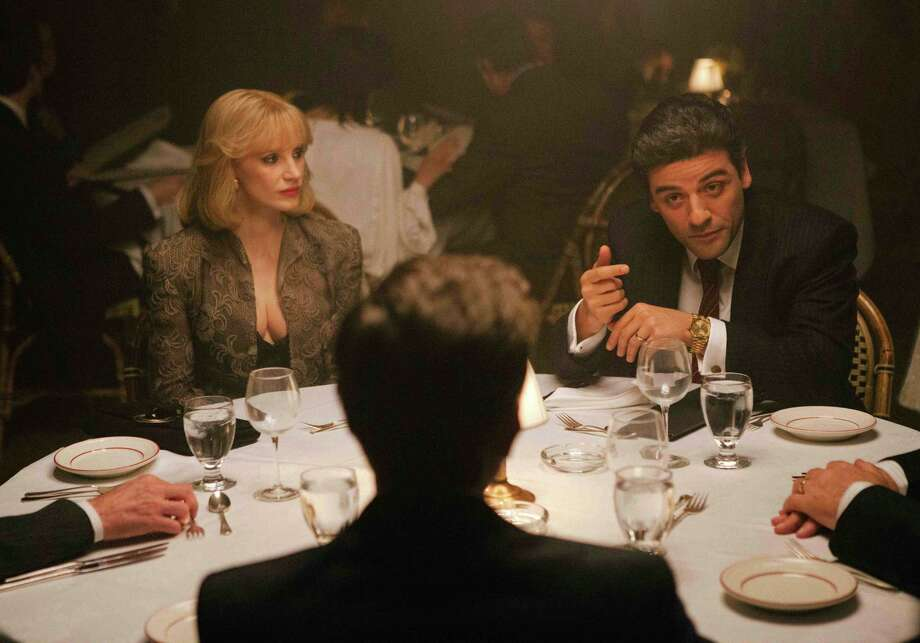 Jessica Chastain and Oscar Isaac are spouses and business partners during the time when if you entered New York City, you held your breath until you could get out of town. Photo: Atsushi Nishijima / Atsushi Nishijima / A24 Films / A24 Films