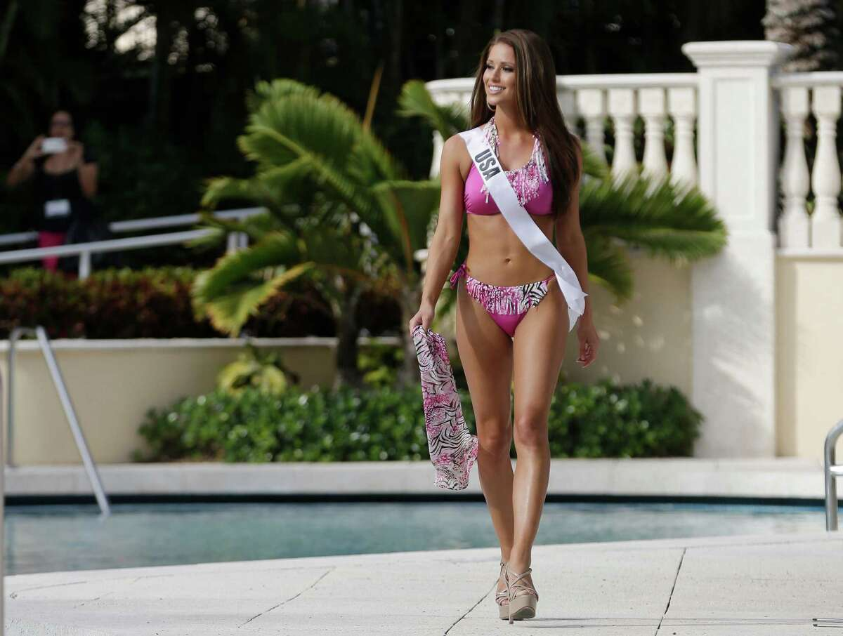 Miss Universe contestant Nia Sanchez, of the USA, walks along the pool during the Yamamay swimsuit runway show, Wednesday, Jan. 14, 2015, in Doral, Fla. The Miss Universe pageant will be held Jan. 25 in Miami.