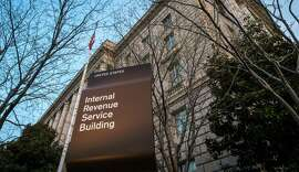 FILE In this April 13, 2014 file photo, the Internal Revenue Service Headquarters (IRS) building is seen in Washington.  The IRS is cutting taxpayer services to historically low levels just as President Barack Obama's health law will make filing a federal tax return more complicated for millions of families.  (AP Photo/J. David Ake, File)