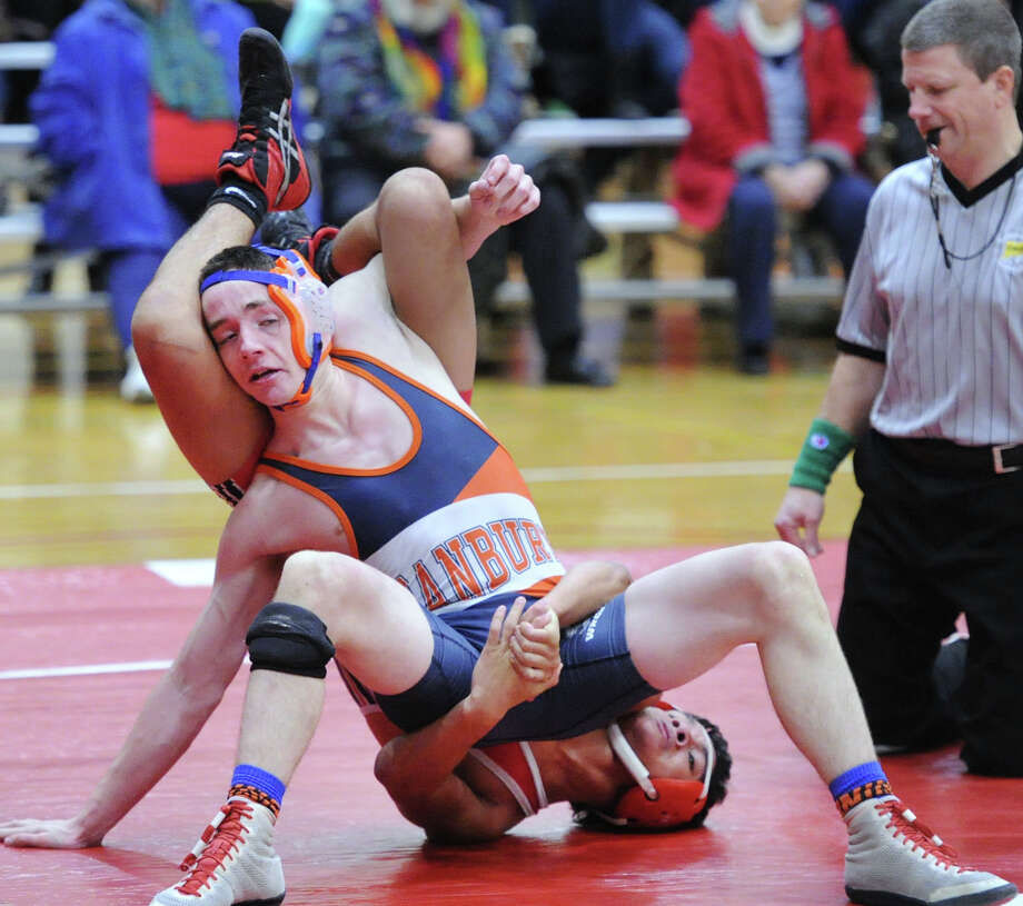 At front Justin Peterson of Danbury in his 132 pound match against Bryce Stanback of Greenwich during the high school wrestling match between Greenwich High School and Danbury High School at Greenwich, Conn., Wednesday, Jan. 14, 2015. Peterson won against Stanback and Danbury took the match 55-18. Photo: Bob Luckey / Greenwich Time