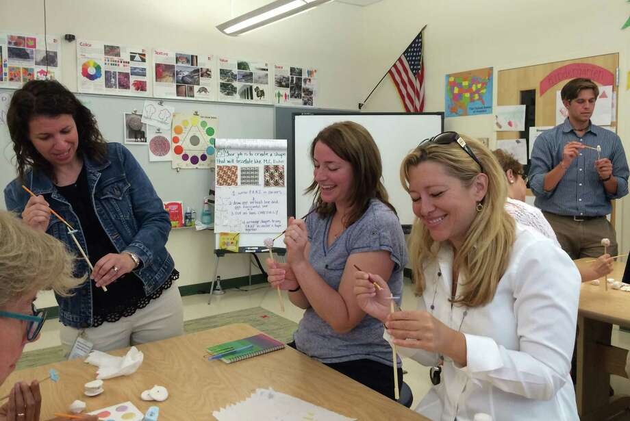 In September, Glenville School teachers painted beads for new bells at the Ben's Bells studio in Newtown. The school has started this school year its own Ben's Bells project. Photo: Contributed Photo / Greenwich Time