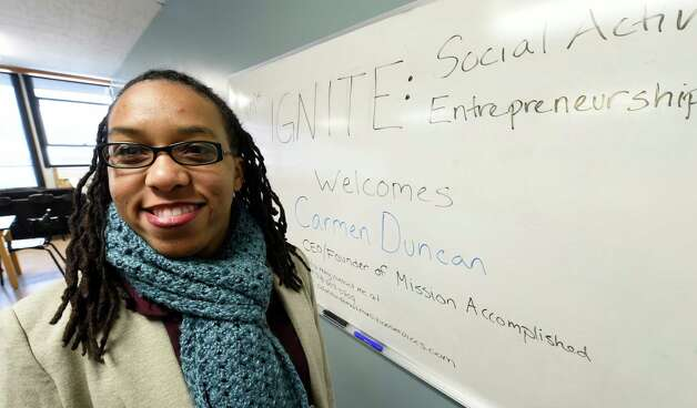 Carmen Duncan prepares to speak to middle school students at the Brown School Wednesday morning Jan. 14, 2015 in Schenectady, N.Y.  The students are in a program to set up their own non-profit companies that will give back to the world.  (Skip Dickstein/Times Union) Photo: SKIP DICKSTEIN / 00030156A