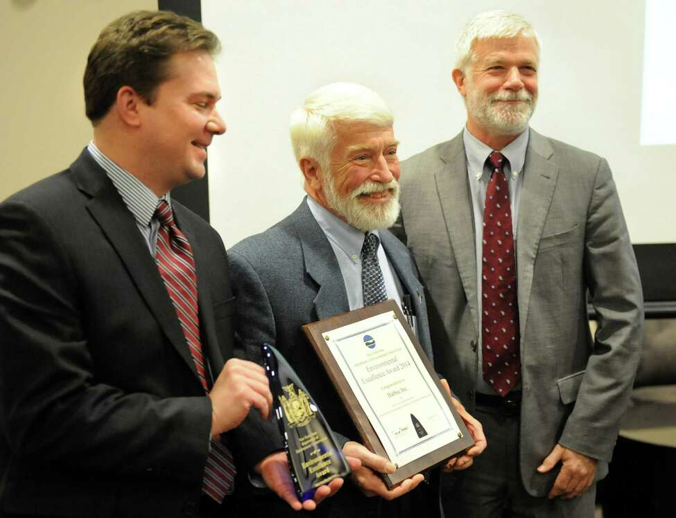 Mark Coleman, left, and Bob Bechtold, center, of Harbec Inc. hold the award for Achieving Carbon Neutrality as they pose with DEC Commissioner Joe Martens during the 11th Annual New York State Environmental Excellence Awards ceremony on Wednesday, Jan. 14, 2015, at SUNY Polytechnic Institute in Albany, N.Y. (Cindy Schultz / Times Union)