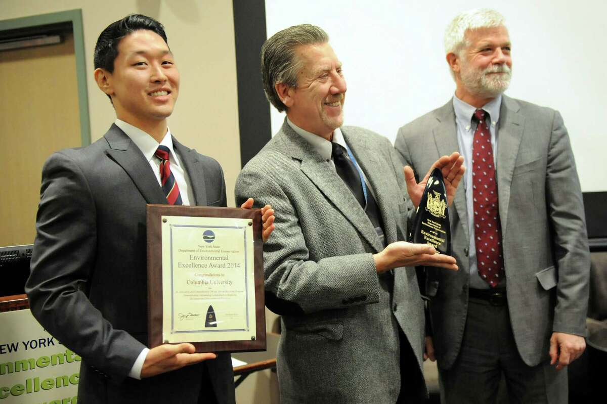 Shane Son, left, and William Hichak, center, of Columbia University hold the award for the school's innovative on-site recycling program as they pose with DEC Commissioner Joe Martens during the 11th Annual New York State Environmental Excellence Awards ceremony on Wednesday, Jan. 14, 2015, at SUNY Polytechnic Institute in Albany, N.Y. (Cindy Schultz / Times Union)