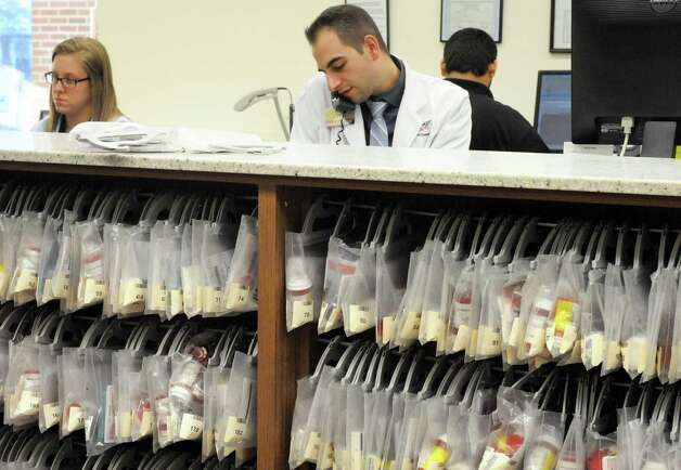 Pharmacist pharmacy manager David Laurenzo and staff fill prescriptions at the Market Bistro by Price Chopper pharmacy on Wednesday, Jan. 14, 2015 in Colonie, N.Y. (Michael P. Farrell/Times Union) Photo: Michael P. Farrell / 00030208A