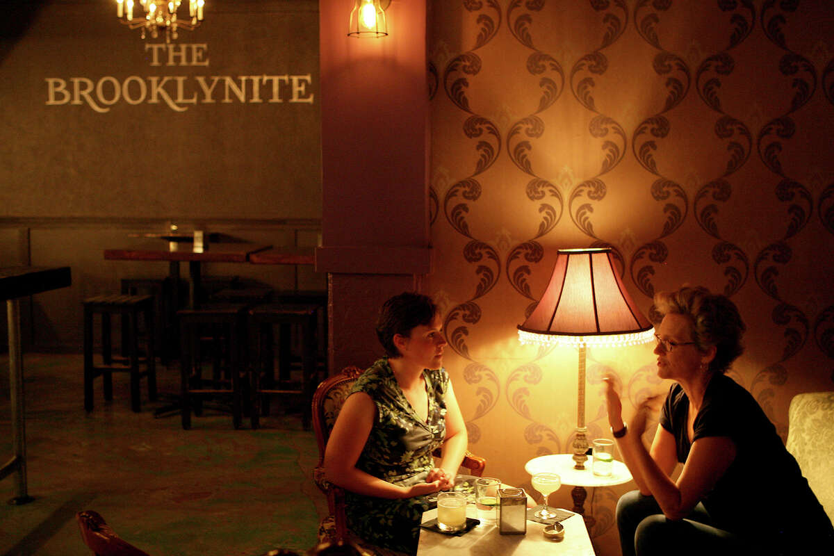 Chrissy Breit (left) and Christine Drennon talk inside The Brooklynite.