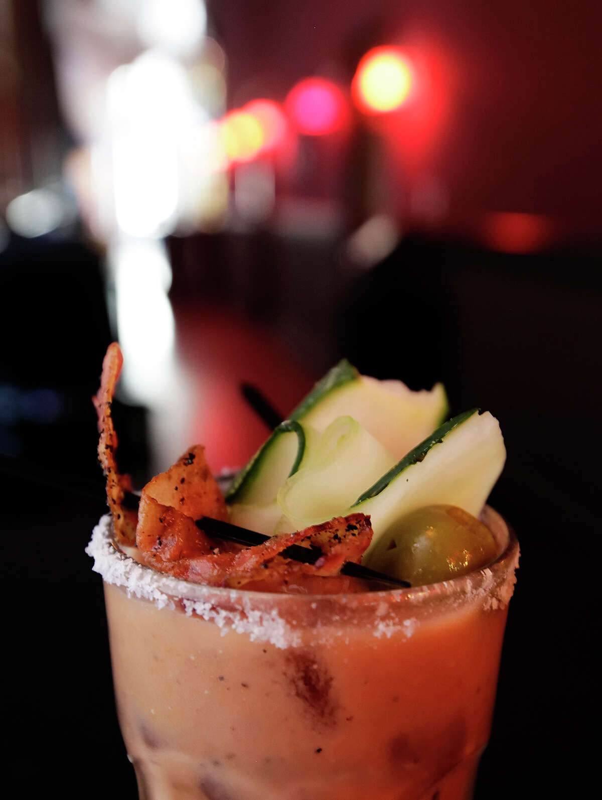 The SoHo bloody mary with both the peppered bacon and cucumber olive garnish at SoHo Wine & Martini Bar.