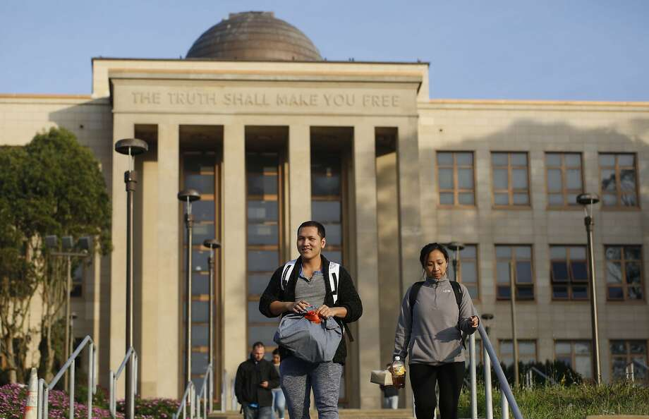 City College of San Francisco Nursing students Jesse Nguyen and Carina Zulueta leave class at the school's the main campus on Wednesday January 14, 2014 in San Francisco, Calif. The accrediting commission granted CCSF two more years to get everything in order to avoid losing accreditation. Photo: Mike Kepka, The Chronicle