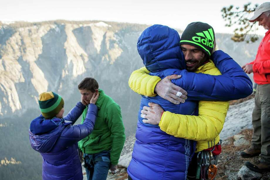 From left: Becca and Tommy Caldwell, and Jacqui Becker and Kevin Jorgeson embrace after the two men completed a free climb summit of the Dawn Wall of El Capitan, in Yosemite National Park, Calif., Jan. 14, 2015. Using ropes as a safety measure only, the duo became the first to climb by hand the 3,000-foot granite wall, an ascent they began on Dec. 27. (Max Whittaker/The New York Times) Photo: MAX WHITTAKER, STR / NYTNS