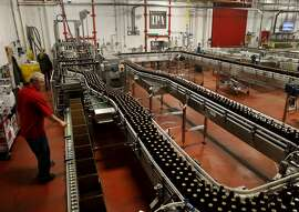 The bottling warehouse for Lagunitas brewery in Petaluma, Calif. Craft brew sensation Lagunitas Brewing Company has dropped its trademark infringement lawsuit against fellow brewer Sierra Nevada Brewing Wednesday January 14, 2015.