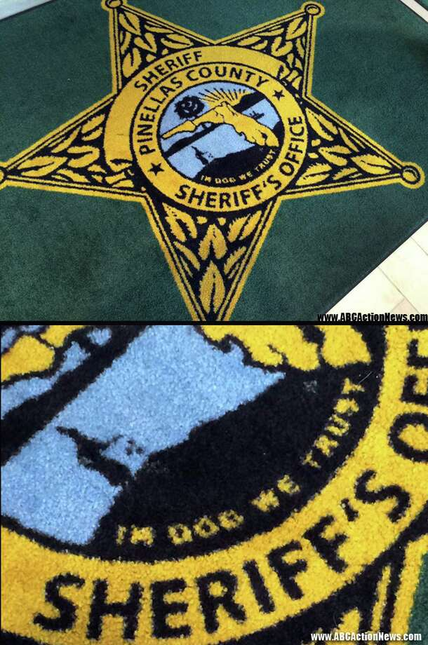 """This image released by ABC Action News, shows the Pinellas County Sheriff's Office rug in Largo, Fla., Wednesday, Jan. 14, 2015. WFTS news reported that the new rugs at the sheriff's administration building say """"In Dog We Trust"""" instead of """"In God We Trust."""" (AP Photo/WFTS-TV/ABC Action News, Adam Winer) ORG XMIT: FLCO101 Photo: Adam Winer / WFTS-TV/ABC Action News"""