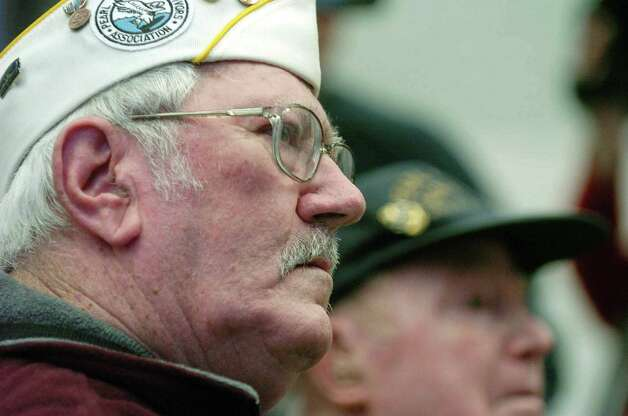 U.S. Navy veterans and Pearl Harbor survivors Charles Ebel, left, of Guilderland and William Langston of Latham during the opening reception for the Pearl Harbor exhibit at the State Vietnam Memorial Gallery in Albany, N.Y. on Wednesday, Dec. 6, 2006. (Paul Buckowski/Times Union archive) Photo: Paul Buckowski / Albany Times Union