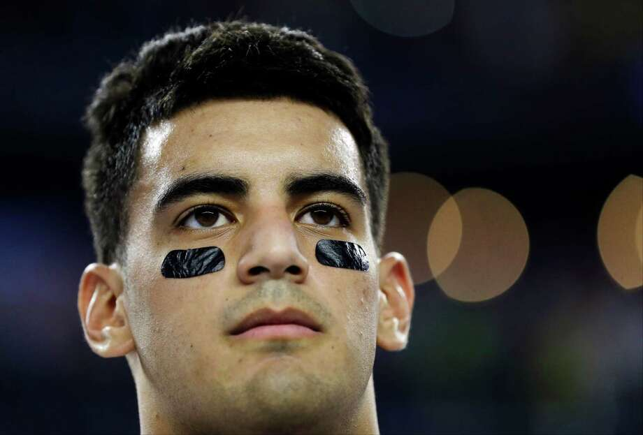 Oregon's Marcus Mariota during the national anthem before the NCAA college football playoff championship game against Ohio State Monday, Jan. 12, 2015, in Arlington, Texas. (AP Photo/David J. Phillip)  ORG XMIT: CFS150 Photo: David J. Phillip / AP