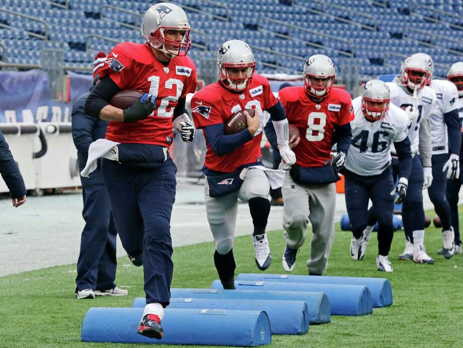New England Patriots quarterback Tom Brady (12) runs through a drill with teammates during NFL football practice at Gillette Stadium in Foxborough, Mass., Wednesday, Jan. 14, 2015.  The Patriots face the Indianapolis Colts in the AFC Championship game on Sunday. (AP Photo/Charles Krupa) ORG XMIT: MACK108 Photo: Charles Krupa / AP