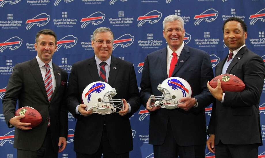 Rex Ryan, second from right, poses for a photo with, from left, Buffalo Bills team president Russ Brandon,  owner and CEO Terry Pegula and general manager Doug Whaley, after Ryan was introduced as the new head coach of the Bills at an NFL football press conference, Wednesday, Jan. 14, 2015, in Orchard Park, N.Y. (AP Photo/Bill Wippert) ORG XMIT: NYBW107 Photo: Bill Wippert / FR170745 AP