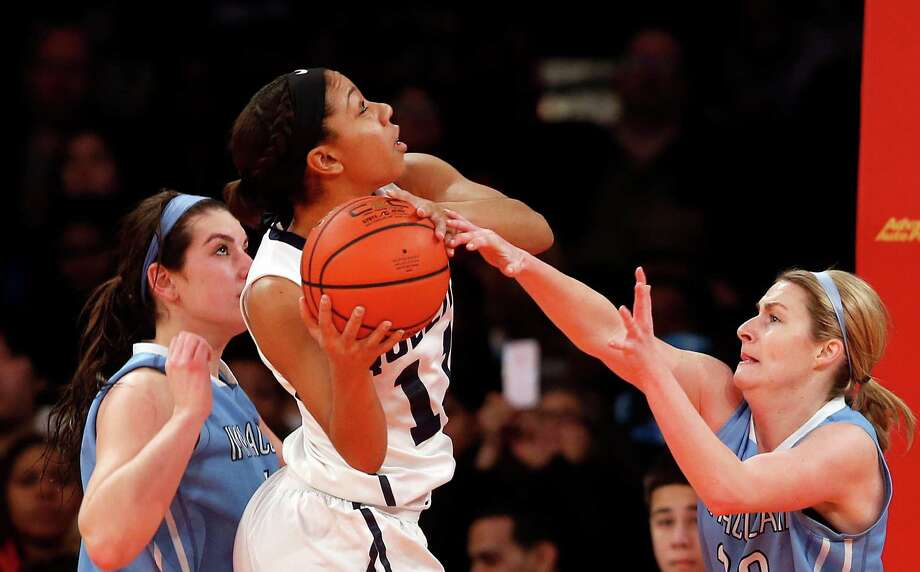 Queens' Madison Rowland, center, goes to the basket against a double team from Immaculata's Brittany Merkle, left, and Sara Smith, right, during the second half of an NCAA college basketball game Sunday, Jan. 4, 2015, in New York. Queens beat Immaculata 76-60. (AP Photo/Jason DeCrow) ORG XMIT: MSG104 Photo: Jason DeCrow / FR103966 AP