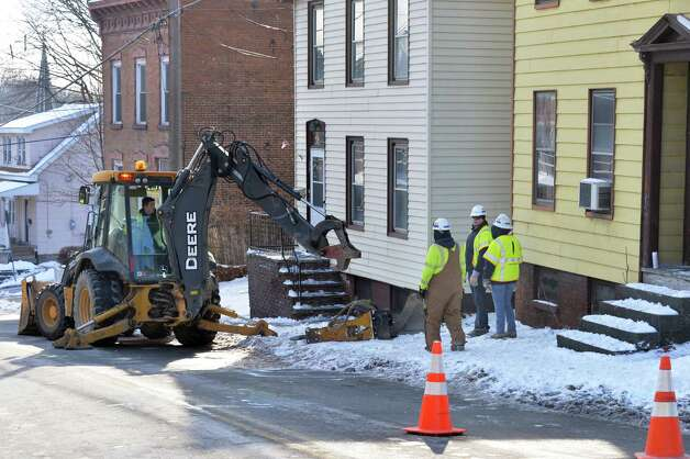 National Grid crews on the scene of a gas leak at 41 Brunswick Ave., right, Wednesday Jan. 14, 2015, in Troy, NY.  (John Carl D'Annibale / Times Union) Photo: John Carl D'Annibale