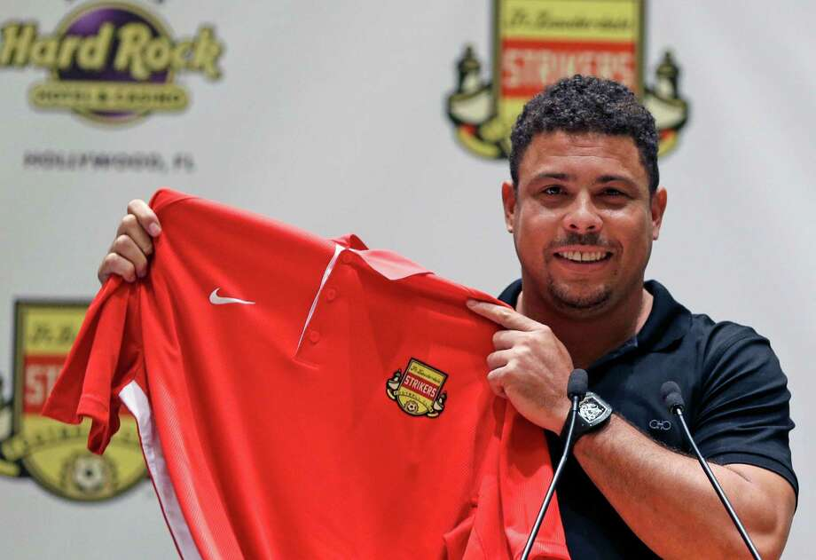 The itch to play again after retiring in 2011 has taken three-time FIFA player of the year Ronaldo to Fort Lauderdale, where he was showing off his jersey for the North American Soccer League team Wednesday. Photo: Alan Diaz, STF / AP