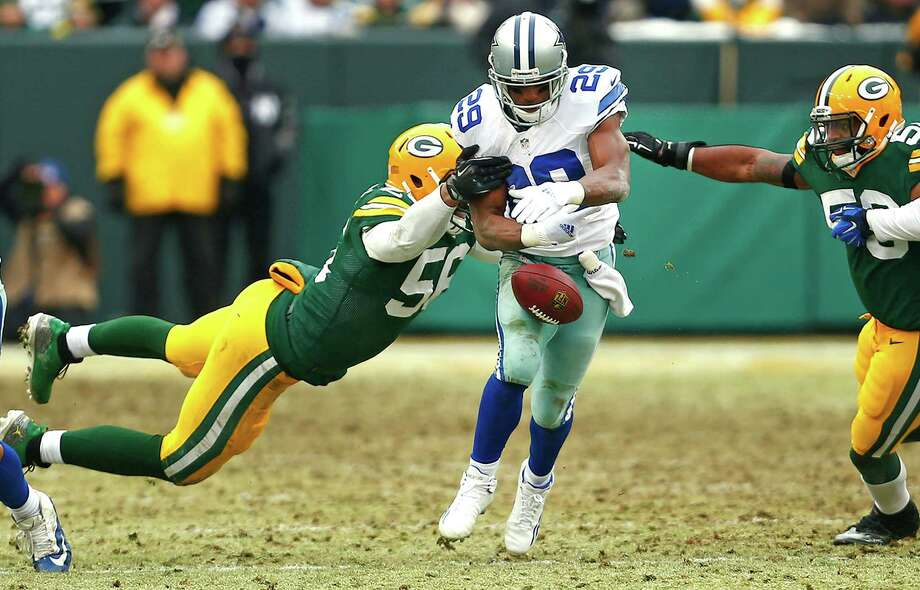 Julius Peppers' strip of Cowboys running back DeMarco Murray was one of the key plays in the Packers' victory Sunday. Photo: Ron Jenkins, MBR / Fort Worth Star-Telegram