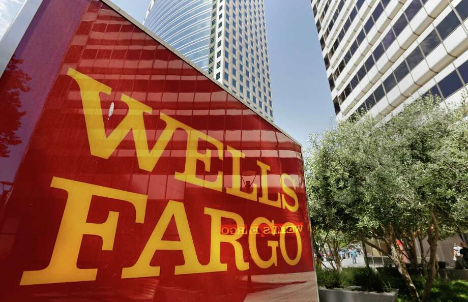 This July 14, 2014 photo shows Wells Fargo offices in Oakland, Calif. Wells Fargo reports quarterly earnings on Wednesday, Jan. 14, 2015. (AP Photo/Ben Margot) Photo: Ben Margot, STF / AP