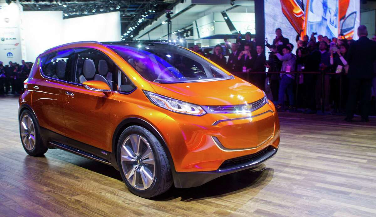FILE - In this Jan. 12, 2015 file photo, the Chevrolet Bolt EV electric concept vehicle is driven onto the stage at a presentation during the North American International Auto Show, in Detroit. The Bolt concept, an electric car with a 200-mile range, could go on sale by 2017. (AP Photo/Tony Ding, File)