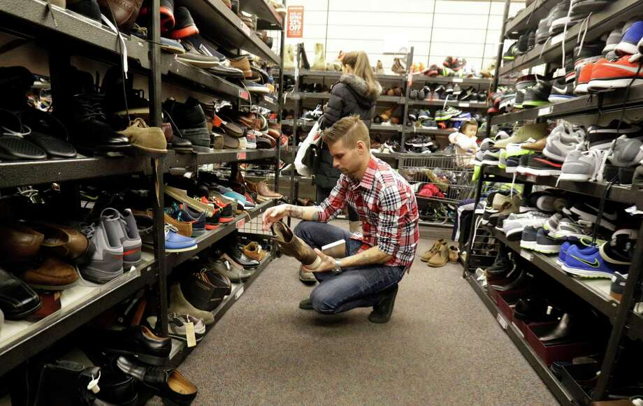 FILE - In this Dec. 26, 2014, file photo, customers shop at Nordstrom Rack in Schaumburg, Ill. Big discounts, and crowds, are expected for the post-Christmas sales. The Commerce Department releases retail sales data for December on Wednesday, Jan. 14, 2015. (AP Photo/Nam Y. Huh, File) Photo: Nam Y. Huh, STF / AP