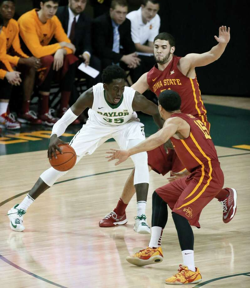 Baylor forward Johnathan Motley (35) looks for an opening to the basket as Iowa State's Georges Niang, rear, and Naz Long (15) defend in the first half of an NCAA college basketball game, Wednesday, Jan. 14, 2015, in Waco, Texas. (AP Photo/Tony Gutierrez) ORG XMIT: TXTG110 Photo: Tony Gutierrez / AP