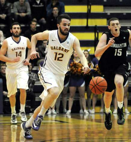 UAlbany's Peter Hooley brings the ball down court during their college basketball game against Binghamton at the SEFCU Arena on Wednesday Jan. 14, 2015 in Albany, N.Y. (Michael P. Farrell/Times Union) Photo: Michael P. Farrell / 00030178A