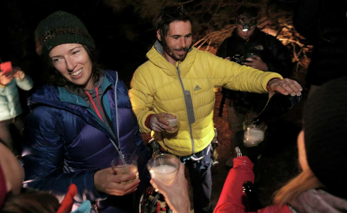 Climber Kevin Jorgeson, (and his girlfriend Jacqui Becker celebrate after coming down back on the Valley floor after his climb up the face of El Capitan with his partner Tommy Caldwell in Yosemite National Park, Calif. The two climbers completed their free climb taking the Dawn Wall route on Wednesday January 14, 2015.