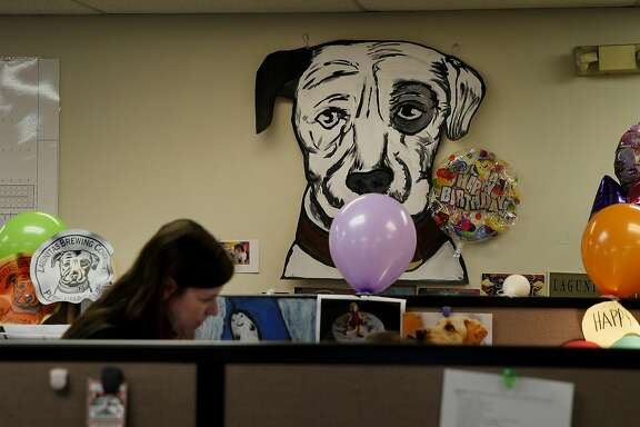 A view of the Lagunitas Brewery office area with the trademark dog illustration in the rear in Petaluma, Calif. Craft brew sensation Lagunitas Brewing Company has dropped its trademark infringement lawsuit against fellow brewer Sierra Nevada Brewing Wednesday January 14, 2015.