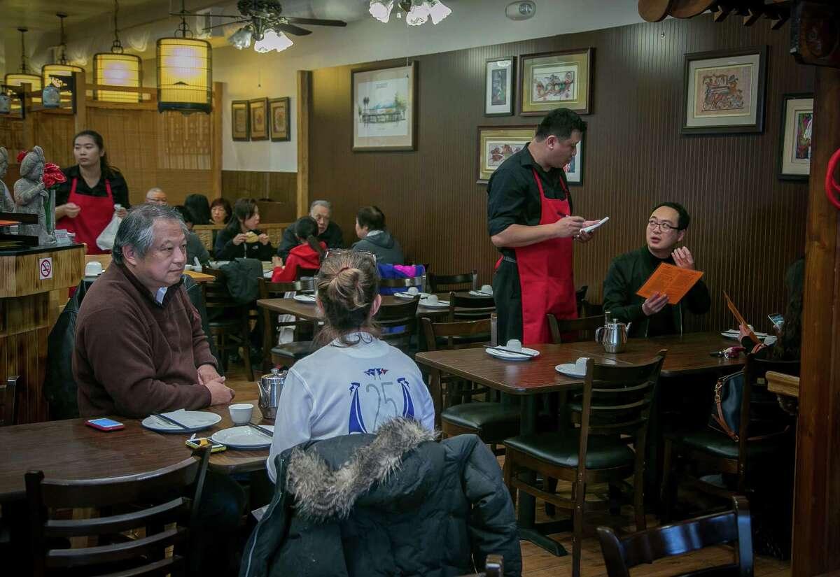 Diners at the Hunan restaurant Wonderful in Millbrae.