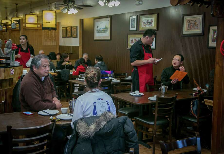 Diners at the Hunan restaurant Wonderful in Millbrae. Photo: John Storey / Special To The Chronicle / ONLINE_YES