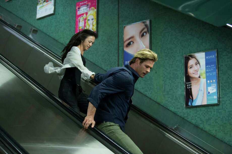 """Chris Hemsworth and Tang Wei star in Legendary Picture's """"Blackhat."""" (Universal Pictures) Photo: Handout, HO / McClatchy-Tribune News Service / Universal Pictures"""