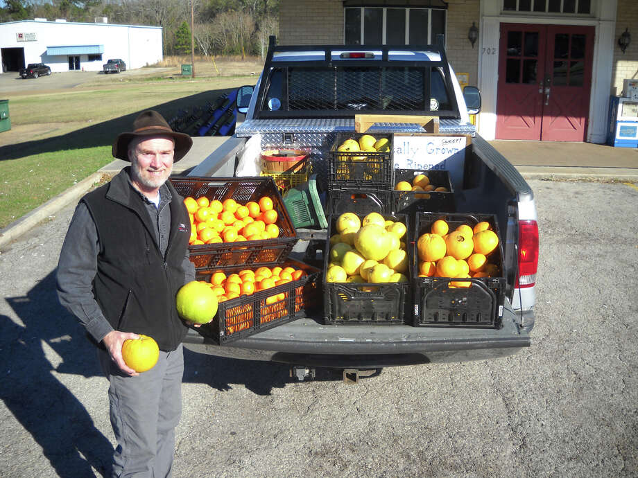 John Dobbs with some of his home grown fruit photo by Patty Lenderman