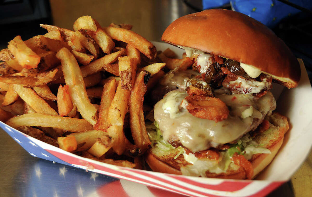 """The """"cheerleader"""" burger at the new Bernie's Burger Bus Stop at Reliant Stadium Sunday August 25, 2013.(Dave Rossman photo)"""
