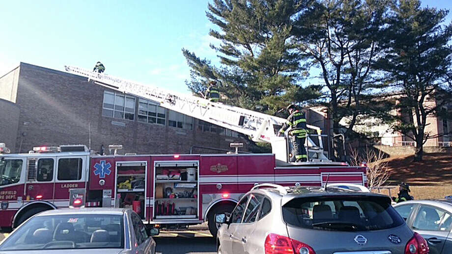 Firefighters on the scene at Fairfield Ludlowe High School where fire broke out in the band room Thursday morning. Photo: Genevieve Reilly / Fairfield Citizen