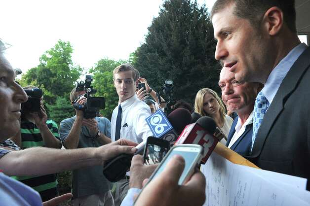 Lawyer Lucas Mihuta, right, with client David Cassidy talks about the status of Cassidy's DWI plea at Town Court on Wednesday Sept. 3, 2014 in Schodack, N.Y.  (Michael P. Farrell/Times Union) ORG XMIT: MER2014090319483702 Photo: Michael P. Farrell / 00028445A