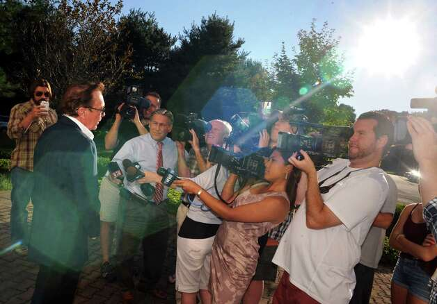 Celebrity David Cassidy, left, talks about the status of his DWI plea at Town Court on Wednesday Sept. 3, 2014 in Schodack, N.Y.  (Michael P. Farrell/Times Union) ORG XMIT: MER2014090319550341 Photo: Michael P. Farrell / 00028445A