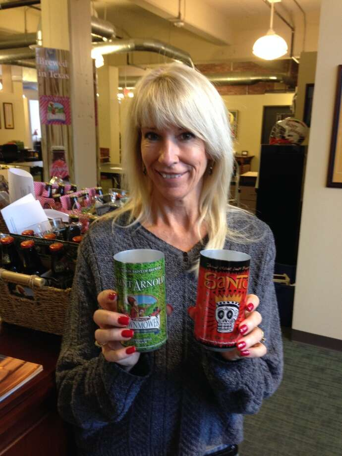 Saint Arnold Brewing Co.'s Kathy Colwell displays new packaging the brewery plans to launch by the end of February. Photo: Ronnie Crocker, Beer, TX