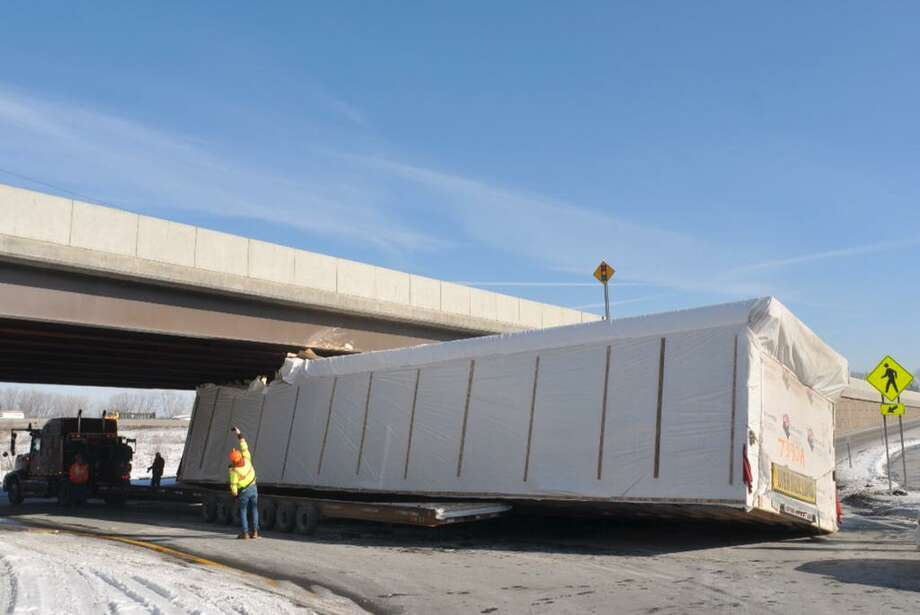 The eastbound side of Fuller Road was closed Thursday after a tractor trailer became wedged in the overpass beneath Washington Avenue Extension. The crash occurred at 11:25 a.m. (Paul Buckowski / Times Union)