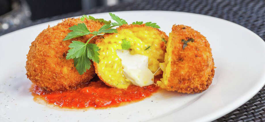 Fried arborio rice balls, flavored with saffron stuffed with peas and fresh mozzarella at Capeesh Italian restaurant in Stamford. Photo: Contributed Photo / Connecticut Post Contributed