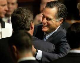 Ex-Mas sa chusetts Gov. Mitt Romney, who is con sidering another bid for presi dent, hugs New Jersey Gov. Chris Chris tie at the State House.