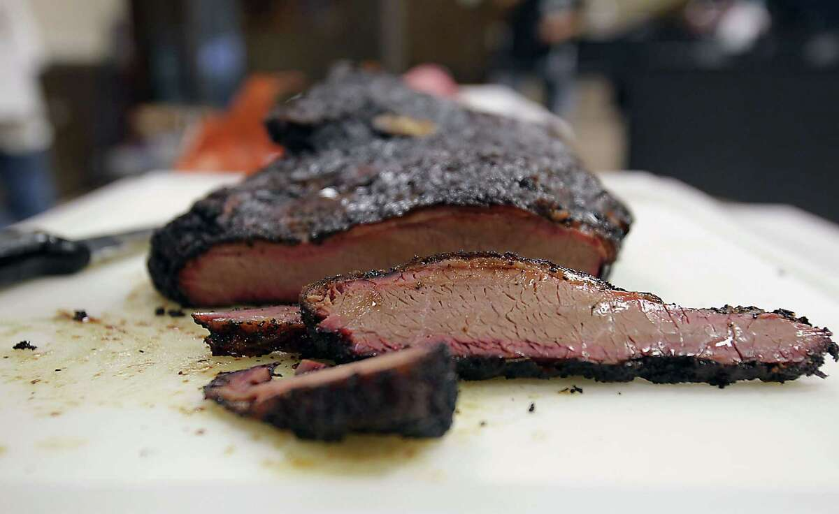 Slices of a smoked brisket during Foodways Texas and Texas A&M University's Camp Brisket.